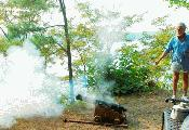 Kent Mountford fires his small salute cannon, sending part of Kenneth Gosner's remains out into Chesapeake Bay.